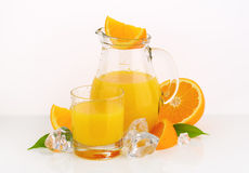 Fresh orange juice. Glass and jug of fresh orange juice on white background Royalty Free Stock Images