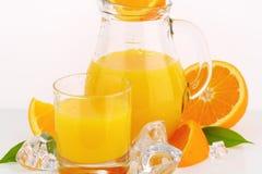 Fresh orange juice. Glass and jug of fresh orange juice on white background - close up Stock Photography