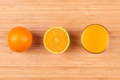 Fresh orange juice glass with sliced fruits Royalty Free Stock Images