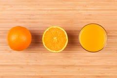 Fresh orange juice glass with sliced fruits Royalty Free Stock Images