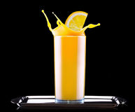 Fresh orange juice in glass with splash Royalty Free Stock Photography