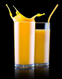 Fresh orange juice in glass with splash Stock Image