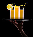 Fresh orange juice in glass with splash Royalty Free Stock Photo