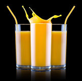 Fresh orange juice in glass with splash Stock Images