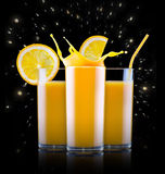 Fresh orange juice in glass with splash Royalty Free Stock Images
