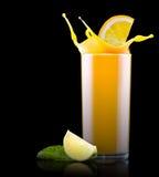 Fresh orange juice in glass with splash Stock Photo