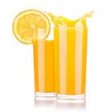 Fresh orange juice in glass with splash Stock Images
