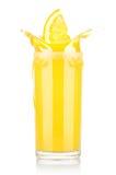 Fresh orange juice in glass with splash Stock Photos