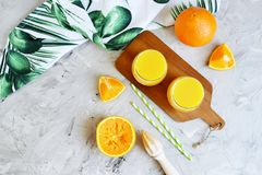 Fresh Orange Juice in the Glass Summer Morning Drink Beverage. Gray Background Vitamins stock photography