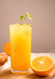 Fresh orange juice in a glass on a wooden panel Stock Photos