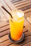 Fresh orange juice and heart ice cube Stock Photo
