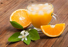 Fresh orange juice just squeezed with ice. Royalty Free Stock Image