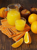 Fresh orange juice and muffins. On a wooden table Royalty Free Stock Image