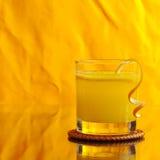 Fresh Orange Juice on Orange Background Royalty Free Stock Photo