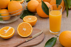 Fresh orange juice and oranges. Royalty Free Stock Image