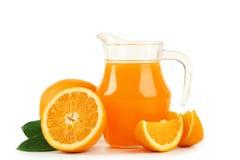 Fresh orange juice in pitcher isolated on white. Royalty Free Stock Photo