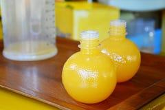 Fresh orange juice in plastic bottles. Stock Photo