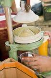 Fresh orange juice   press machine Stock Photos