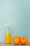Fresh Orange Juice in Retro Bottle with Straws and Grouped Orang Royalty Free Stock Images