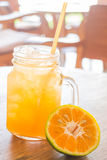 Fresh orange juice serving on wooden table Royalty Free Stock Images