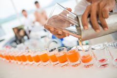 Fresh orange juice in shot glasses Royalty Free Stock Photo