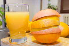 Fresh orange juice and slices on wooden board Royalty Free Stock Images