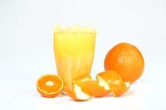 Fresh orange juice splashing. Fresh orange juice splashing on white background royalty free stock photo