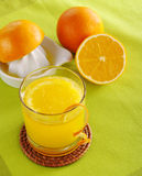 Fresh Orange Juice with Squeezer Royalty Free Stock Photography