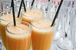 Fresh orange juice with a straw. Royalty Free Stock Photography