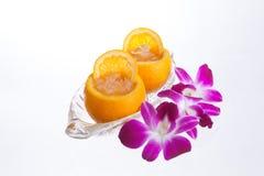Fresh orange juice on white blackground. Orange juice in orange peel  in isolate white background Stock Images
