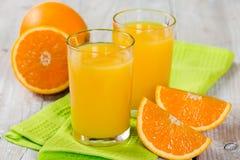 Fresh orange juice. On a wooden background Stock Photos