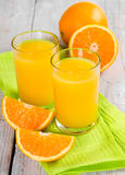 Fresh orange juice. On a wooden background Stock Image