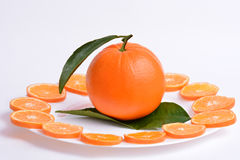 Fresh orange with leaves cut in slices Royalty Free Stock Photo