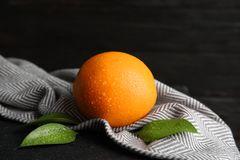 Fresh orange with leaves and napkin. On table stock images