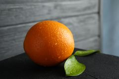 Fresh orange with leaves on table. Closeup stock photos