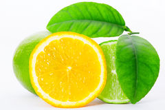 Fresh orange with lime and leaf on white background Royalty Free Stock Photo