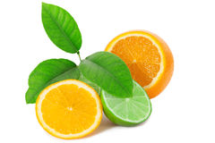 Fresh orange with lime and leaf on white background Stock Photo