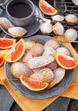 Fresh orange madeleines cookies Stock Photos