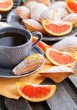 Fresh orange madeleines cookies Stock Images