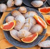 Fresh orange madeleines cookies Stock Photography