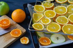 Fresh orange, mandarin and apple slices stock photography