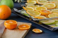 Fresh orange, mandarin and apple slices on the tray royalty free stock image