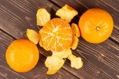Free Fresh Orange Mandarine On Brown Wood Stock Photos - 163087523