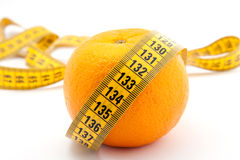 Fresh orange with measuring tape Royalty Free Stock Image