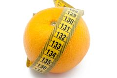 Fresh orange with measuring tape Stock Photo