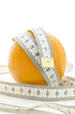 Fresh orange with measuring tape Royalty Free Stock Photos