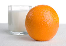 Fresh orange with milk on background Royalty Free Stock Images
