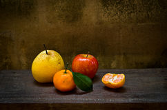 Fresh orange ,pear and apple on wood table Royalty Free Stock Photography