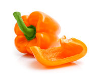 Fresh orange peppers with cut isolated on white Royalty Free Stock Photography