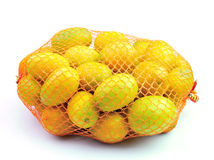 Fresh orange in plastic netting Stock Photos